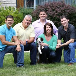 Cheri is a proud mother and grandmother. Here she is pictured with her husband, Gerry Bustos, and her three sons.
