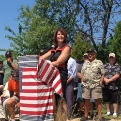 Cheri works hard every day to honor the sacrifices of veterans and service members. On Memorial Day this year, she spoke at the LZ Peace Memorial in Rockford, honoring those who fought in Vietnam and died from the effects of Agent Orange.